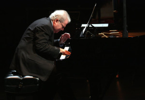 Emanuel Ax playing with musicians from the New York Philharmonic.