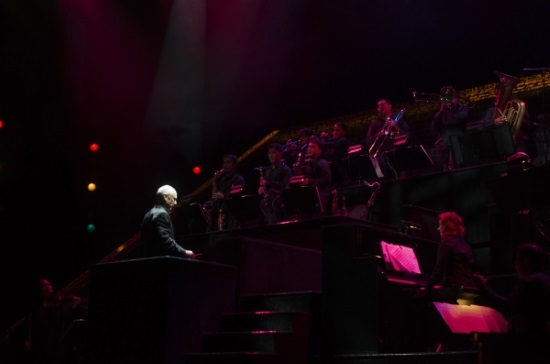 Robert Billig on the podium with one of the orchestras from the current tour of Chicago.